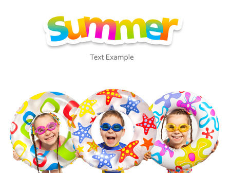 Happy kids look out of inflatable ring. Isolated on white background. Vacation, summer, sea concept. Foto de archivo