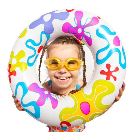 frendship: Happy kids look out of inflatable ring. Isolated on white background. Vacation, summer, sea concept. Stock Photo
