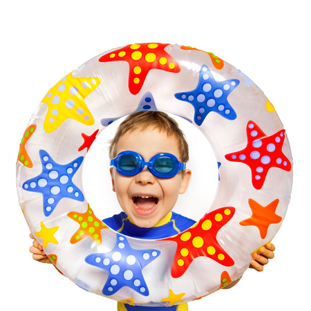 Happy kids look out of inflatable ring. Isolated on white background. Vacation, summer, sea concept. Archivio Fotografico