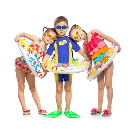 Happy kids in swimsuit and inflatable rings. Isolated on white background. Summer, fashionable, friendship concept.