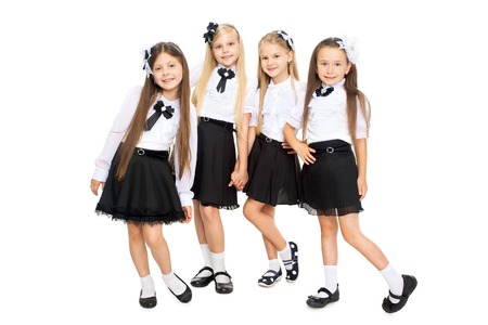 schoolgirls: Group of smiling schoolgirls in school uniform, isolated on white background. Education, fashion, friendship concept.