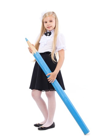 little girl dress: Pretty blonde schoolgirl with big blue pencil, isolated on a white background. School, fashion, education concept.