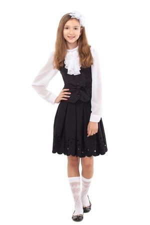uniformes: Colegiala bonita aislada en un fondo blanco. Escuela, la moda, el concepto de la educaci�n. Foto de archivo