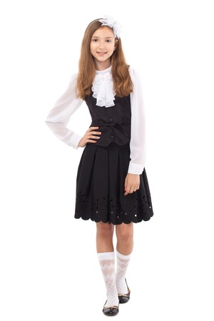 uniforms: Pretty schoolgirl isolated on a white background. School, fashion, education concept.