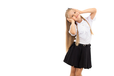 Pretty blonde schoolgirl isolated on a white background. School, fashion, education concept.
