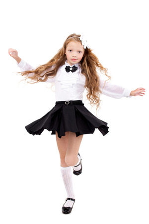 Pretty redhead schoolgirl isolated on a white background. School, fashion, education concept.