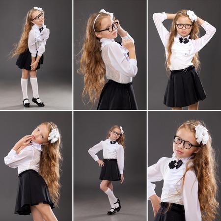 petite fille avec robe: Écolière de la jolie rouquine sur fond sombre. L'école, la mode, le concept de l'éducation