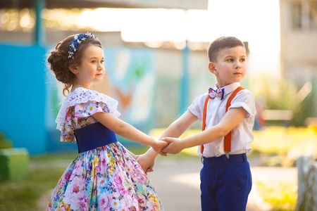 cute boy and girl holding hands valentine s day love story stock