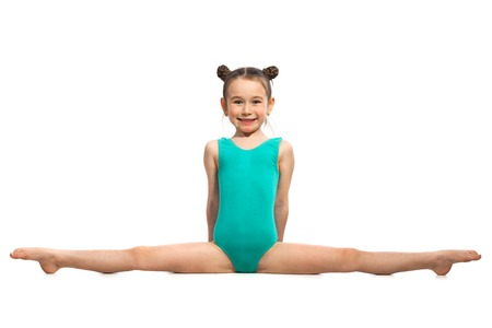 Little girl gymnast sitting in the cross splits. Isolated on white background. Sport, active lifestyle concept Stok Fotoğraf - 66088211