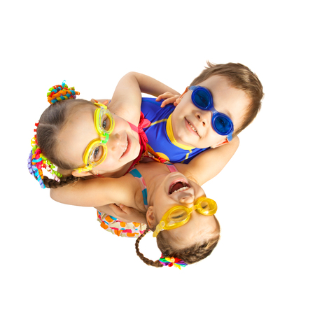 frendship: Happy kids hugging. Isolated on white background. Pool and sea concept.