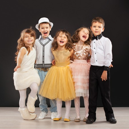 fashion clothes: Group of fashionable kids in celebratory clothes. Holidays, party, fashion concept.
