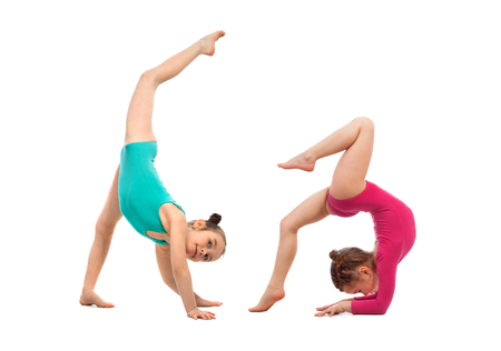 acrobatic: Flexible kids gymnasts doing acrobatic feat, isolated on white background. Sport, active lifestyle concept Stock Photo
