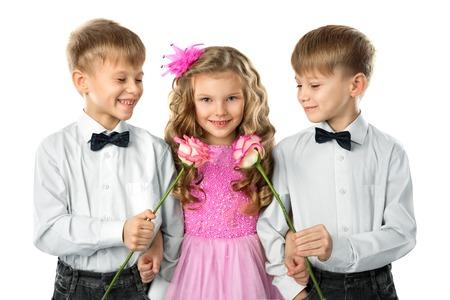 beautiful boys: Two twin boys gives a flowers beautiful little girl