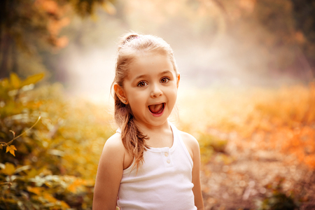 Children Smiling Happiness Concept. Outdoor portrait of a cute smiling little girl.