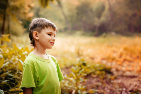 Outdoor portrait of a cute boy. Children Smiling Happiness Concept