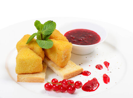 The cheese in breadcrumbs with currant jam photo