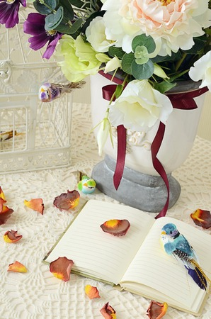 The book on a table with rose-petals photo