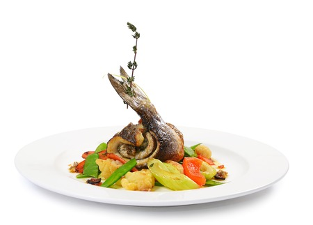 seafood salad: Sea bass fillet with spring vegetables and olive sauce