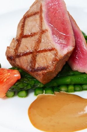 Tuna a grill with an asparagus close-up photo