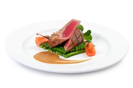 Tuna a grill with an asparagus close-up photo