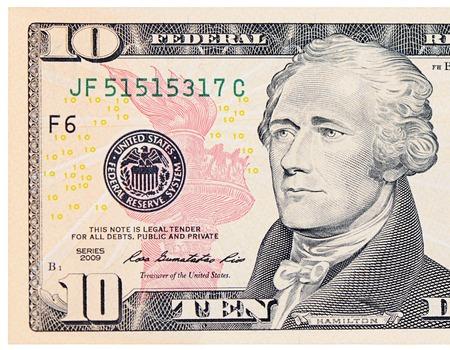 Los diez dólares aislados sobre fondo blanco Foto de archivo - 27675827