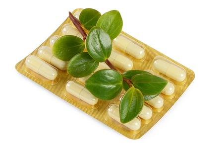 Tablets with a plant close-up. Medical concept photo
