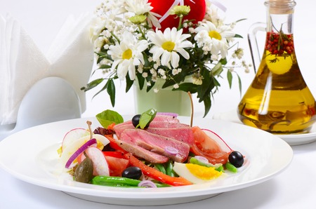 Nicoise with fresh tuna and vegetables   close-up photo