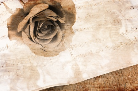 The rose on notebooks with musical notes photo