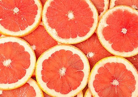 The fresh grapefruit as a background closeup Archivio Fotografico