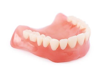 Set of false teeth isolated on white