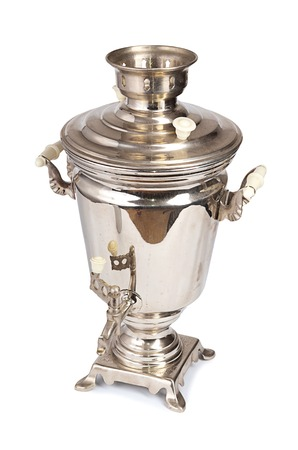 Silver old samovar isolated on white background photo