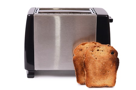 The silver toaster isolated on white background photo