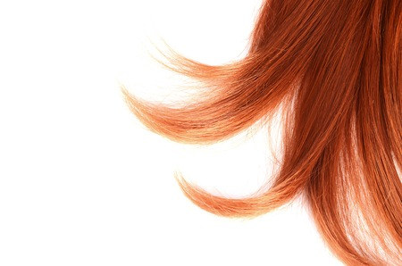 The red hair isolated on white background photo