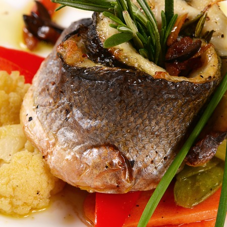Seabass fillet with spring vegetables and sauce photo