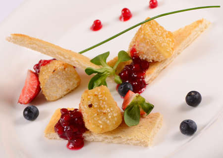 breadcrumbs: The cheese in breadcrumbs with currant jam Stock Photo
