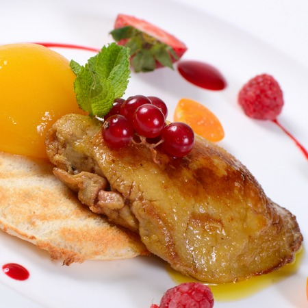 Foie Gras with toast and apricot close-up photo