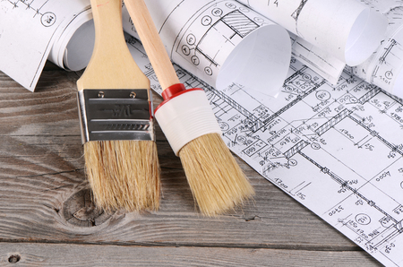Projects of houses on the wooden background Stock Photo - 29335773