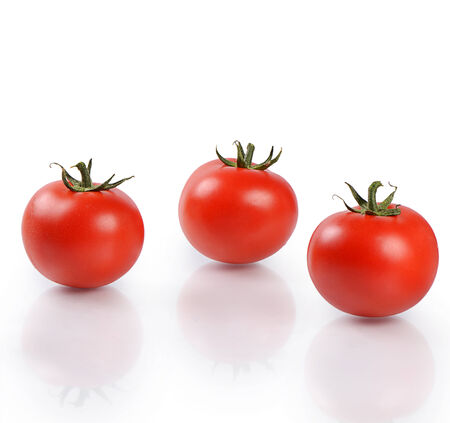 Red fresh tomatoes isolated on white background Stock Photo