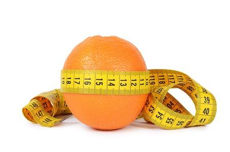 Measuring tape with orange isolated on white photo