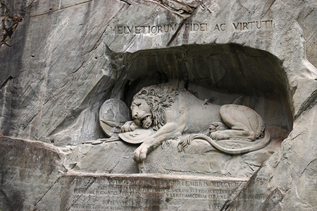dying: Statue of a dying lion in Lucerne Stock Photo