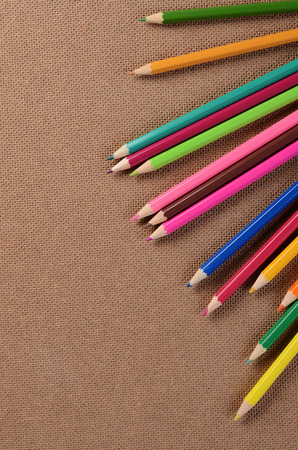 Color pencils on a board. School concept photo
