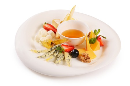 The assorted cheese with honey with strawberries Фото со стока