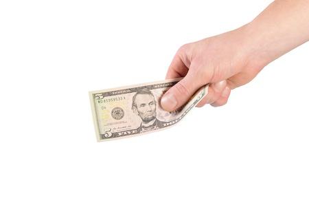 Dólares en la mano del hombre aislado en blanco Foto de archivo