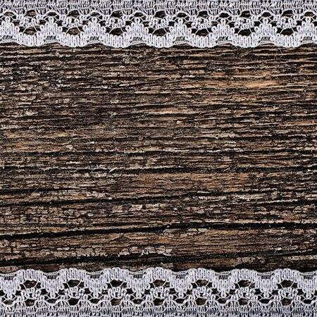 openwork: The openwork lace on a wooden background