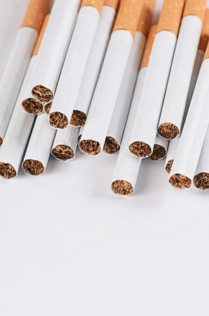vices: Close-up of Tobacco Cigarettes Background or texture Stock Photo
