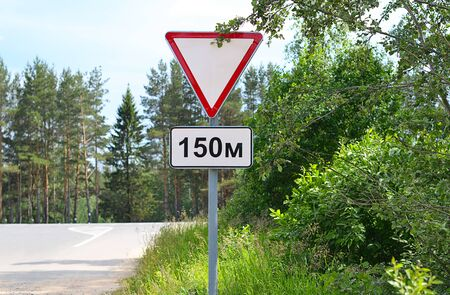 Road sign on the edge of slopes Stock Photo