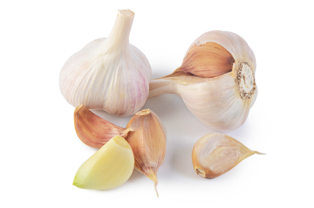 Fresh garlic closeup isolated on a white background Фото со стока