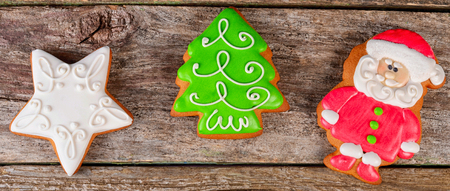 Gingerbread winter Christmas tree on wooden background