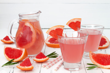cocktail: Refreshing grapefruit and rosemary cocktail over old vintage wooden table