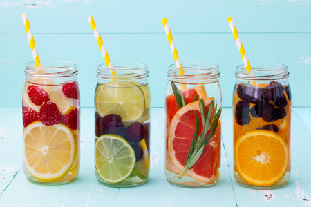 Detox fruit infused flavored water. Refreshing summer homemade cocktail 스톡 콘텐츠